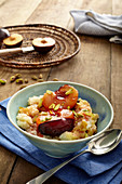 Cardamom rice pudding with plum compote