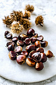 Edible chestnuts cleaned and unpeeled on a marble board