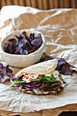 Donner kebab with mushrooms and purple potato crisps