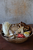 Various mushrooms in a wooden bowl