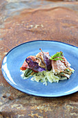 Mushroom saltimboca with fennel and purple potato crisps