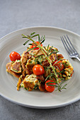 Shredded mushroom pancake with caramelised cherry tomatoes and herbs