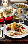 American turkey with roast potatoes and vegetables