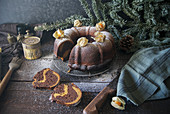 A chocolate and pumpkin wreath cake garnished with physalis