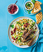 Turkish lamb kofta with hummus, chickpeas, cucumber, feta, and pomegranate seeds