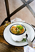 Herb soup in an enamel mug
