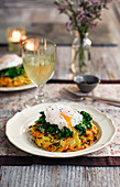 A potato and carrot rösti with spring onions and poached egg