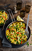 Vegetable paella with artichokes