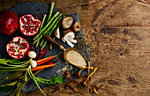 Still life with vegetables, pomegranate, mushrooms and cereals