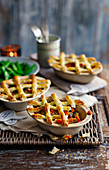 Vegetable pies with pastry lattices