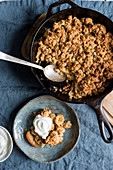 Apple and banana oat crumble with almonds served with greek yogurt