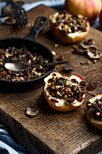 Baked apples with walnuts, raisins and dried plums
