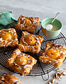 Danish pastries with apricots and icing