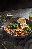 Vegeterian chickpea and spinach curry with coriander and poppadoms