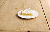 A piece of lemon meringue pie (lemon cake with meringue, USA)