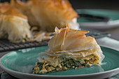 A piece of spanakopita (filo pastry with spinach and feta cheese, Greece)