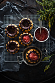 Small vegan vanilla gugelhupfs with dark chocolate, filled with strawberry and rhubarb compote