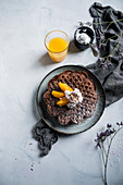 Vegan chocolate waffles with orange fillets, soy butter cream and grated chocolate