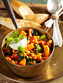 Sweet potato curry with chickpeas, cinnamon, tomato, spinach, garam masala, coriander and natural yoghurt (India)