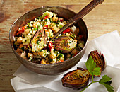 Couscous and chickpea salad with fried mini artichokes