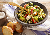 Greek millet salad with feta, cucumber, tomato and green olives