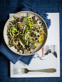 Beluga lentil salad with puntarelle, sardine, and sage skewers