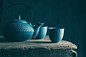 Asiatische Teekanne und Teebecher