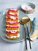 Éclairs with smoked fish cream and radish jelly