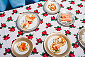 Blinis with sour cream, smoked salmon, and salmon caviar