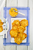 Potato pancakes with applesauce on a blue and white cloth