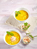 Yellow lentil and pineapple soup with curry, ginger, chili and coconut
