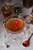 A Manhattan Cocktail Garnished with Maraschino Cherries