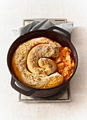 Pepper goulash with a caraway pretzel crust