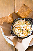 Fish gratin with potatoes, fennel and cheese