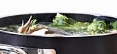 Fish stock in a saucepan