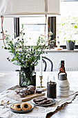 Table set with simple, rustic accessories and pastries