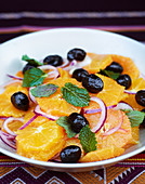 Orange salad with onions, black olives and mint