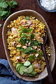Blumenkohlreis mit Curryhuhn und Erdnüssen