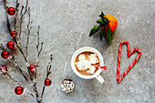 Flat-lay of hot chocolate with whipped cream and Christmas decor