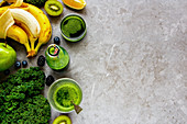 Healthy ingredients for making detox smoothie drink over grey concrete background