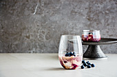 Delicious blueberry dessert in glass with fresh berries