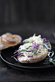 Half a bread roll topped with coleslaw