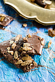 Pumpkin spice and seed chocolate almond bark with golden raisins