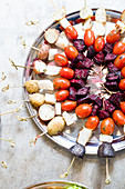 Colorful vegetable skewers or kabobs on a silver tray at a party