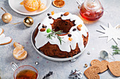 Christmas cake with dried fruits soaked in rum and sugar glaze