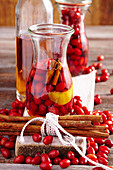 Cornelian cherries, in rum with cinnamon and lemon zest, in a bottle