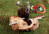Elderberry and blackberry jam on buttered bread and in a glass jar