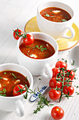 Vegetarian tomato soup with amaranth and fresh herbs