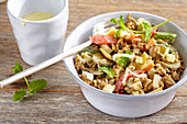 Fruity and spicy spelt salad with cheese and apple, peppers, gherkins and cream dressing