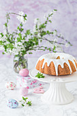 Easter bundt cake with royal icing, on a cake stand